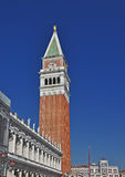 The Campanile in St Mark's Square Venice. A view of the beaautiful campanile or bell tower on Venice's picturesque waterfront Royalty Free Stock Image