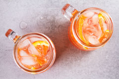 Campari and vermouth cocktail with oranges, garnished with thyme. Stock Photos