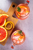 Campari and vermouth cocktail with oranges, garnished with thyme. Royalty Free Stock Photo