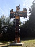 Campbell River Totem Pole, British Columbia. BC First Nations totem pole on display in front of the Campbell River Museum.  Depicting the carving work of the Stock Photo