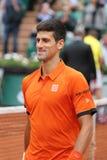 Campeão Novak Djokovic do grand slam de oito vezes durante o segundo fósforo do círculo em Roland Garros 2015 Imagens de Stock