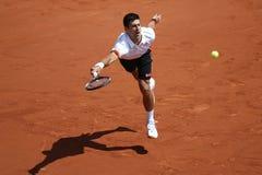 Campeão Novak Djokovic do grand slam de oito vezes durante o terceiro fósforo do círculo em Roland Garros 2015 Imagem de Stock