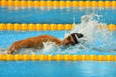 Campeão olímpico Gregorio Paltrinieri de Itália na ação durante o ` s dos homens final de um estilo livre de 1500 medidores do Ri Imagem de Stock