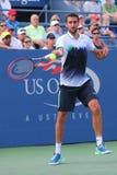 Campeón Marin Cilic del US Open 2014 de Croacia durante el partido redondo 4 del US Open 2014 Foto de archivo libre de regalías