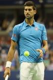 Campeón Novak Djokovic del Grand Slam de doce veces de Serbia en la acción durante su partido del cuarto de final en el US Open 2 Foto de archivo