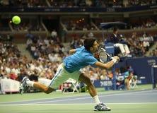Campeón Novak Djokovic del Grand Slam de doce veces de Serbia en la acción durante su partido del cuarto de final en el US Open 2 Imagenes de archivo