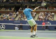 Campeón Novak Djokovic del Grand Slam de doce veces de Serbia en la acción durante su partido del cuarto de final en el US Open 2 Fotos de archivo