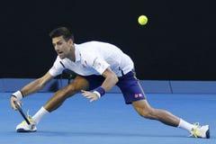 Campeón Novak Djokovic del Grand Slam de once veces de Serbia en la acción durante su partido de la ronda 4 en Abierto de Austral Foto de archivo