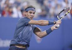 Campeón Rafael Nadal del Grand Slam de doce veces durante su cuarto partido de la ronda en el US Open 2013 contra Philipp Kohlschr Fotografía de archivo