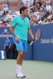 Campeón Roger Federer del Grand Slam de diecisiete veces durante el partido 2014 de semifinal del US Open contra Marin Cilic Imagen de archivo libre de regalías