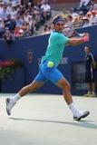 Campeón Roger Federer del Grand Slam de diecisiete veces durante partido de semifinal en el US Open 2014 Fotografía de archivo