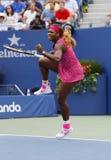 Campeón Serena Williams del Grand Slam durante cuarto partido de la ronda en el US Open 2014 Foto de archivo
