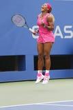 Campeón Serena Williams del Grand Slam durante tercero partido de la ronda en el US Open 2014 Foto de archivo libre de regalías