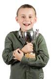 Campeón sonriente con su trofeo Foto de archivo libre de regalías