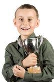 Campeón sonriente con su trofeo Imagen de archivo libre de regalías