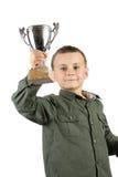 Campeón sonriente con su trofeo fotos de archivo