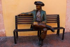 CAMPECHE, MEXICO: Bronze statue in front of the Casa Don Gustavo Hotel, San Francisco de Campeche, man in an old suit and hat sits stock photo