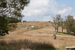 Campeggiatori sul prato di Whigg Fotografie Stock