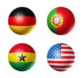 Campeonato do mundo de Brasil bandeiras de G de 2014 grupos na bola de futebol Foto de Stock