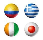 Campeonato do mundo de Brasil bandeiras de 2014 grupos C na bola de futebol Imagem de Stock