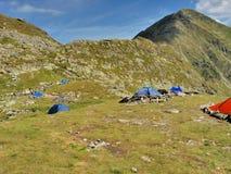 Camper alpin de tentes Photographie stock