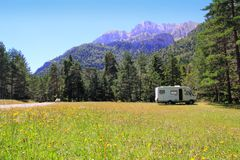 Camper autocaravan meadow in Pyrenees mountain Royalty Free Stock Photography