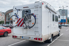 Camper with bicycle in city Stock Photos