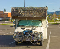 A camper with bicycles attached parked in a lot in idaho Royalty Free Stock Photography