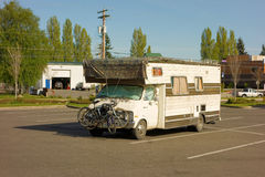 A camper with bicycles attached parked in a lot in idaho Royalty Free Stock Photo