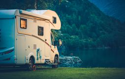 Camper Camping at the Lake. Camper Camping at the Glacier Lake. Camper Van Vacation stock image