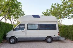 Camper on a camping site Royalty Free Stock Photo