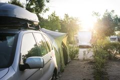 Camper in campsite. At the morning sunrise royalty free stock image