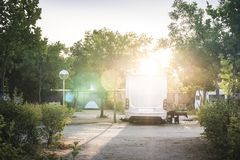Camper in campsite. At the morning sunrise royalty free stock photo