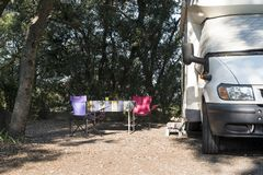Camper in campsite. At the morning sunrise royalty free stock photography