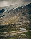 Camper car in norwegian mountains stock photos