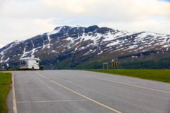 Camper car in norwegian mountains. Tourism vacation and travel. Camper van motorhome in norwegian mountains Royalty Free Stock Photos