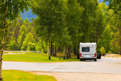 Camper car in norwegian mountains. Tourism vacation and travel. Camper van on camping site rest place in norwegian mountains Stock Images