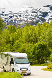 Camper car in norwegian mountains. Tourism vacation and travel. Camper van and norwegian mountains landscape Royalty Free Stock Photos