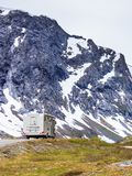 Camper car in norwegian mountains. Tourism vacation and travel. Camper van and mountains landscape in Norway Royalty Free Stock Photos