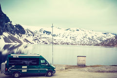 Camper car in norwegian mountains stock photography