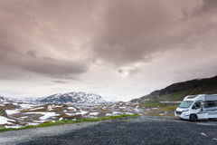 Camper car in norwegian mountains. Tourism vacation and travel. Camper van motorhome on camping site rest place in norwegian mountains Royalty Free Stock Photography