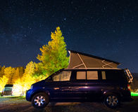 Camper car under a sky full of stars Stock Image