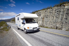 Camper in Finland. A white camper on a scenic road of Lapland, Finland royalty free stock photos