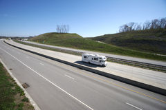 Camper on the Highway. (Wide Angle View Royalty Free Stock Photos