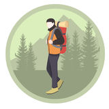 Camper man with backpack in forest. Royalty Free Stock Photography