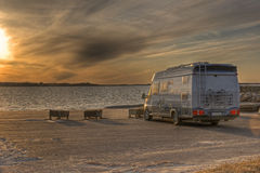 Camper parked on the beach in HDR. Dramatic sunset with caravan at a beach parking in Sweden Europa......in HDR Stock Image