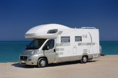 Camper parked on the beach. In Sardinia, Italy Stock Photos