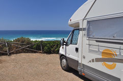 Camper parked on the beach Stock Image