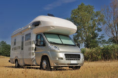 Camper parked in a countryside Stock Images
