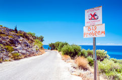 Camper problem danger sign on the way to beach. Camper problem danger sign on the way to Greece Lefkada beach Royalty Free Stock Photos